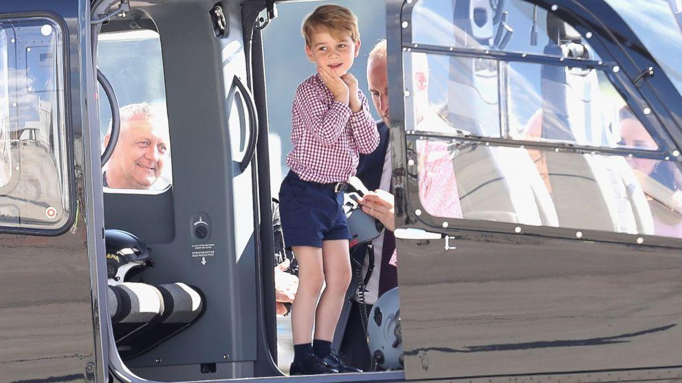 Prince George climbs in helicopter cockpit as Prince William and Princess Kate depart Germany (ABC News)