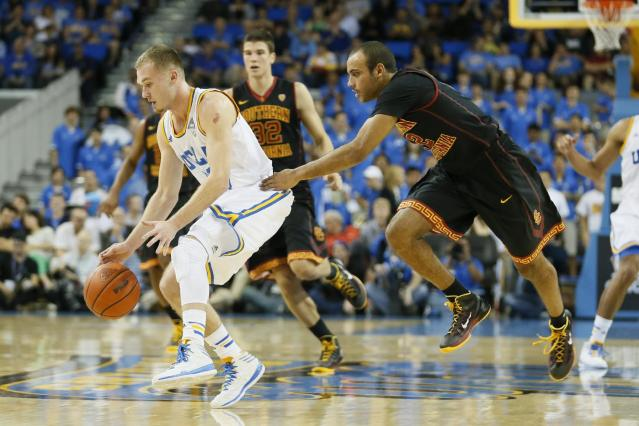 UCLA's Bryce Alford, left, steals the ball from Southern California's Julian Jocobs, right, during the first half of an NCAA college basketball game on Sunday, Jan. 5, 2014, in Los Angeles. (AP Photo/Danny Moloshok)