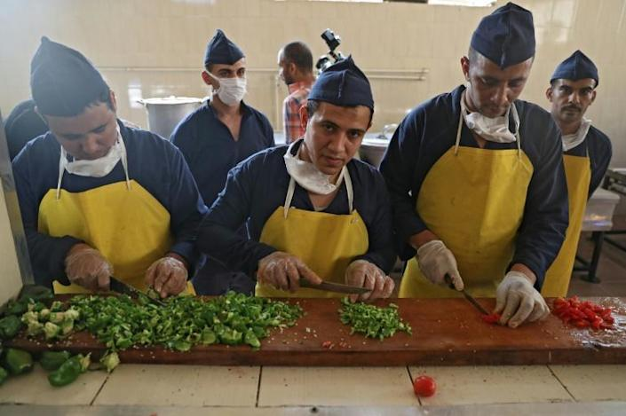 During a guided tour, shows inmates cook and serve food for visitors to Tora prison in the Egyptian capital (AFP Photo/Mohamed el-Shahed)