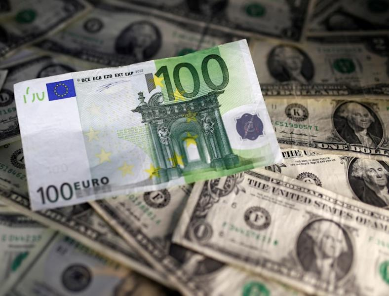U.S. dollar and Euro notes are seen in this picture illustration