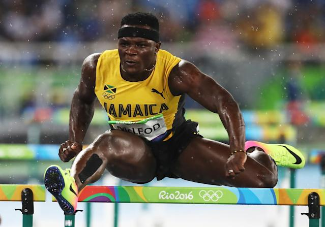 <p>Omar Mcleod of Jamaica competes during the Men's 110m Hurdles Round 1 – Heat 1 on Day 10 of the Rio 2016 Olympic Games at the Olympic Stadium on August 15, 2016 in Rio de Janeiro, Brazil. (G </p>