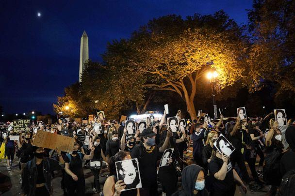 PHOTO: Demonstrators march near the White House in protest following a Kentucky grand jury decision in the Breonna Taylor case, Sept. 23, 2020, in Washington, DC. (Drew Angerer/Getty Images)