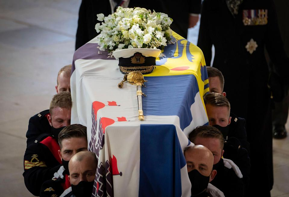 Pall Bearers carry the coffin during the funeral of the Duke of Edinburgh in St Georges Chapel, Windsor Castle, in Windsor.