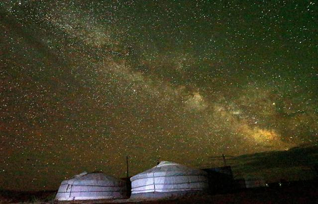 """<p>The """"Milky Way"""" is seen across the sky in the early morning hours at the Takhin Tal National Park, part of the Great Gobi B Strictly Protected Area, in south-west Mongolia, June 23, 2017. (Photo: David W. Cerny/Reuters) </p>"""