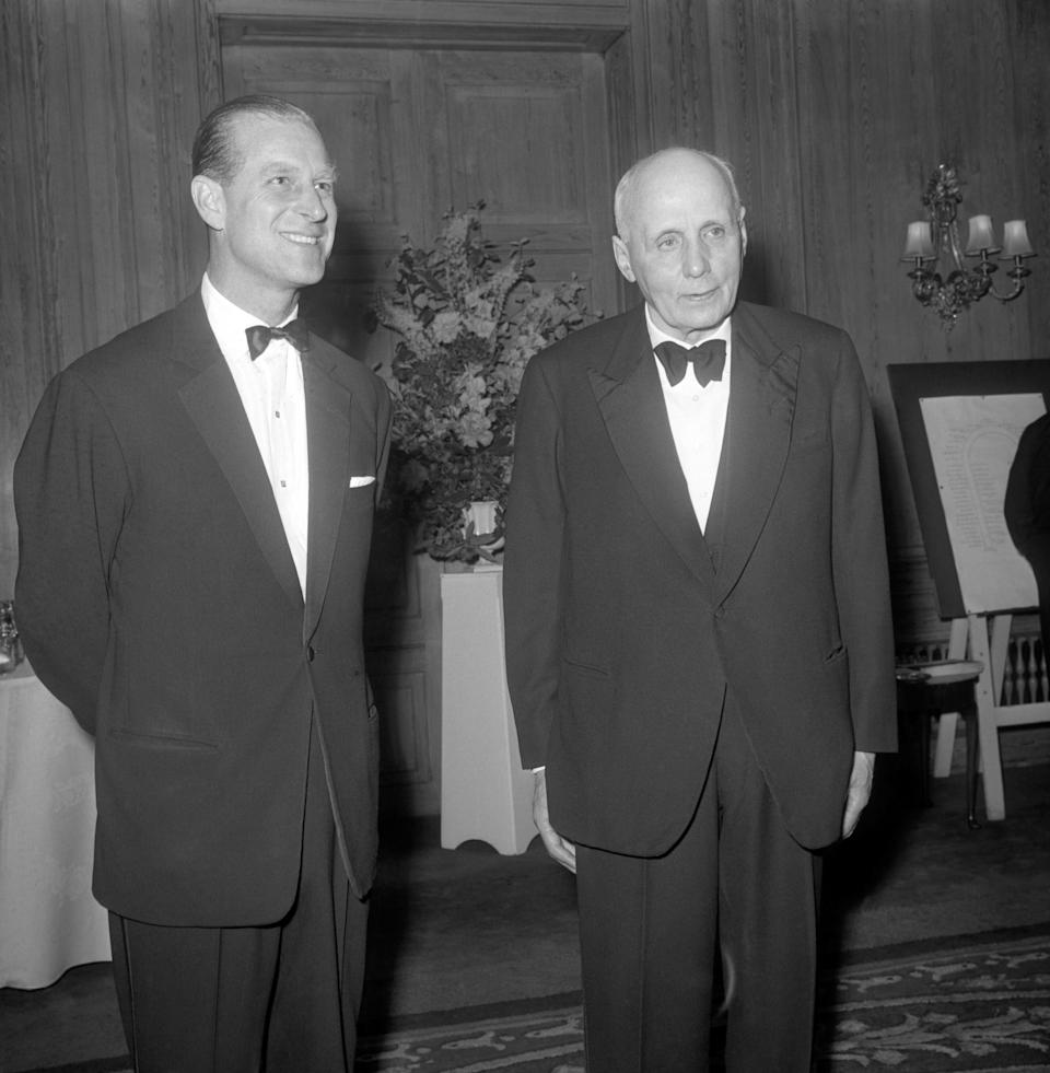 Prince Philip, The Duke of Edinburgh, ex pupil of Gordonstoun, meets his old headmaster, Dr. Kurt Hahn, at a dinner given in the doctor's honour by The Friends of Gordonstoun. Dr. Hahn, who is 77, founded Salem School in Germany and the Duke studied there for a year. When Dr. Hahn moved the school to Scotland, the Duke went with it. Dr. Hahn retired in 1953   (Photo by PA Images via Getty Images)