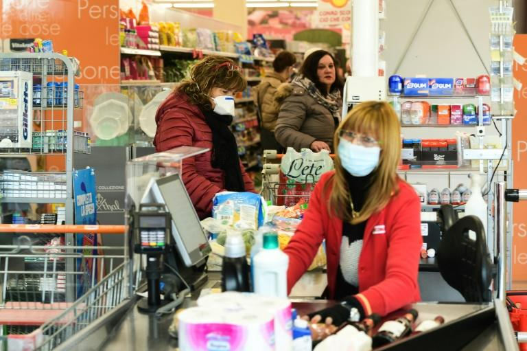 One supermarket in the quarantine area allowed 40 customers inside at a time and warned that the quantity of some products might be limited (AFP Photo/Miguel MEDINA)