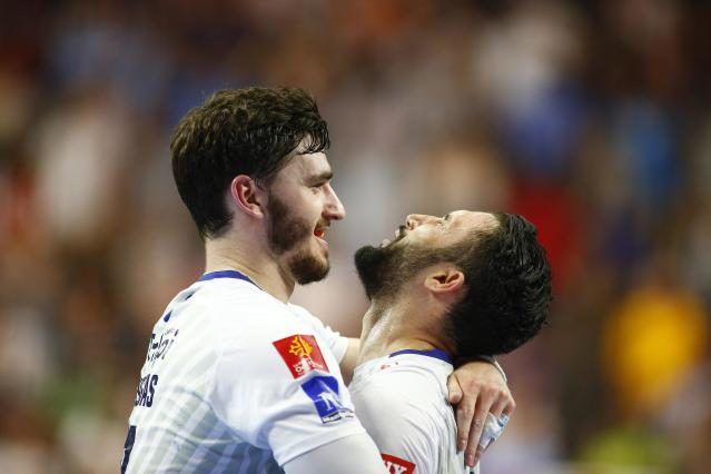 Handball - Men's EHF Champions League Final - HBC Nantes vs Montpellier HB - Lanxess Arena, Cologne, Germany - May 27, 2018. Ludovic Fabregas and Mohamed Soussi of Montpellier HB celebrate winning the match. REUTERS/Thilo Schmuelgen