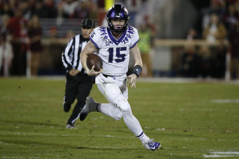 TCU quarterback Max Duggan (15) carries during an NCAA college football game against Oklahoma in Norman, Okla., Saturday, Nov. 23, 2019. (AP Photo/Sue Ogrocki)