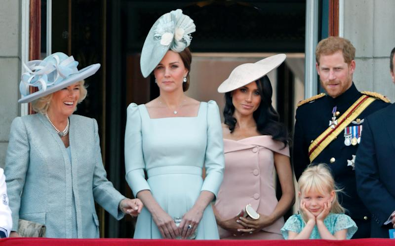 LONDON, UNITED KINGDOM - JUNE 09: (EMBARGOED FOR PUBLICATION IN UK NEWSPAPERS UNTIL 24 HOURS AFTER CREATE DATE AND TIME) Camilla, Duchess of Cornwall, Catherine, Duchess of Cambridge, Meghan, Duchess of Sussex, Prince Harry, Duke of Sussex and Isla Phillips stand on the balcony of Buckingham Palace during Trooping The Colour 2018 on June 9, 2018 in London, England. The annual ceremony involving over 1400 guardsmen and cavalry, is believed to have first been performed during the reign of King Charles II. The parade marks the official birthday of the Sovereign, even though the Queen's actual birthday is on April 21st. (Photo by Max Mumby/Indigo/Getty Images)