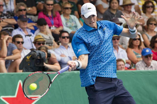 John Isner of the U.S. returns a shot to Taiwan's Lu Yen-hsun in their men's singles final match at the Heineken Open tennis tournament in Auckland, New Zealand, Saturday, Jan. 11, 2014. (AP Photo/SNPA, David Rowland)