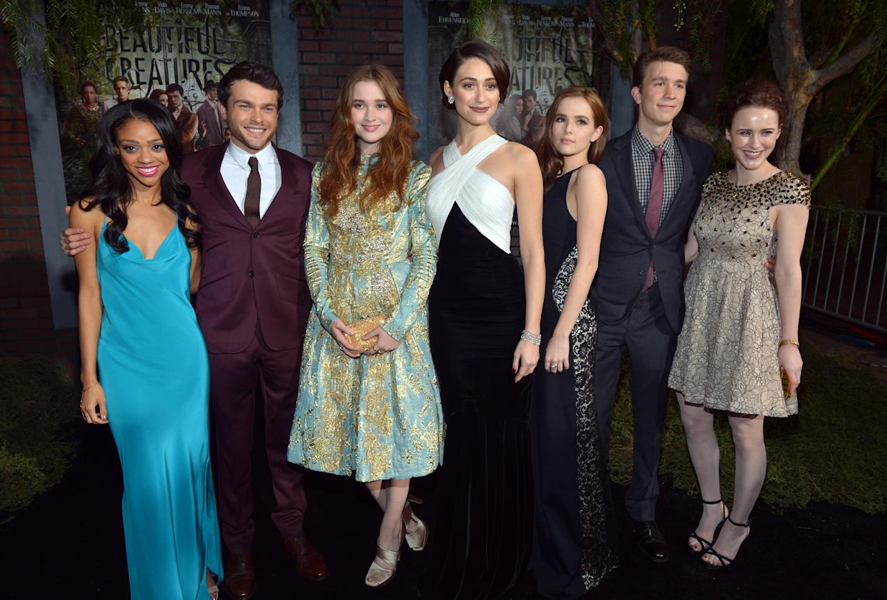 """HOLLYWOOD, CA - FEBRUARY 06:  (L-R) Actors Tiffany Boone, Alden Ehrenreich, Alice Englert, Emmy Rossum, Zoey Deutch, Thomas Mann and  Rachel Brosnahan attend the Los Angeles premiere of Warner Bros. Pictures' """"Beautiful Creatures"""" at TCL Chinese Theatre on February 6, 2013 in Hollywood, California.  (Photo by Alberto E. Rodriguez/Getty Images)"""