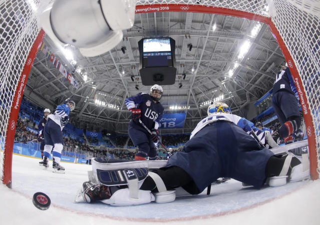 <p>The puck shot by Jocelyne Lamoureux-Davidson, of the United States, sails past goalie Noora Raty (41), of Finland, during the second period of the semifinal round of the women's hockey game at the 2018 Winter Olympics in Gangneung, South Korea, Monday, Feb. 19, 2018. (Matt Slocum/Pool Photo via AP) </p>