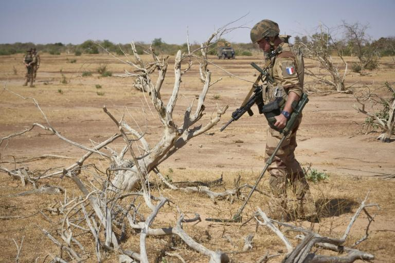 A French soldier on an exercise in Burkina Faso uses a bomb detector as he searches for a roadside device, one of the deadliest tactics used by jihadists