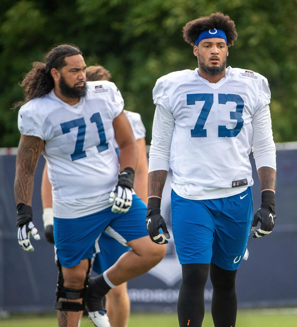 Indianapolis Colts offensive tackle Sam Tevi (71) and Indianapolis Colts offensive tackle Julien Davenport (73) at Grand Park in Westfield on Monday, August 10, 2021, on the third week of workouts of this summer's Colts training camp.