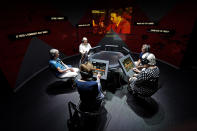 People take part in an interactive exhibit about the red scare during a tour of the Harry S. Truman Presidential Library and Museum Wednesday, June 9, 2021, in Independence, Mo. The facility will reopen July 2 after a nearly $30 million renovation project. (AP Photo/Charlie Riedel)