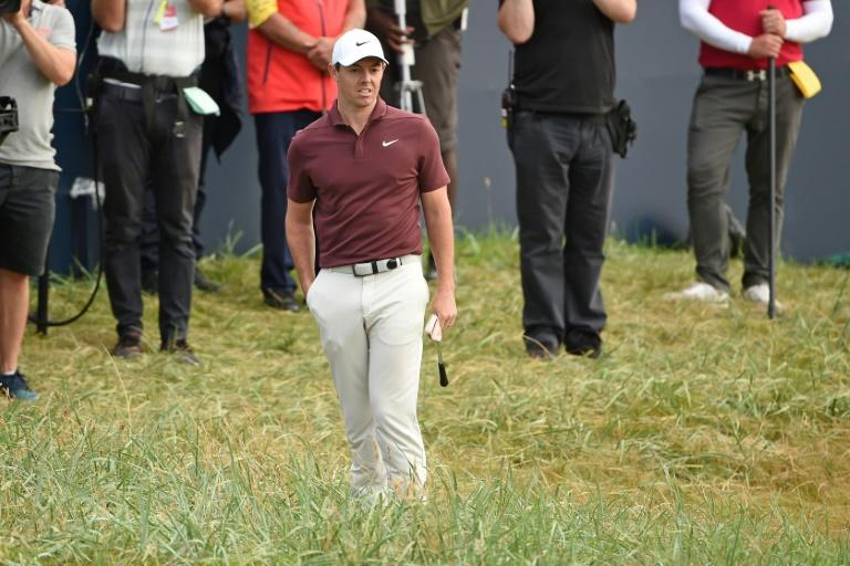 Northern Ireland's Rory McIlroy waits in the rough beside the 18th green during his third round on day 3 of the British Open