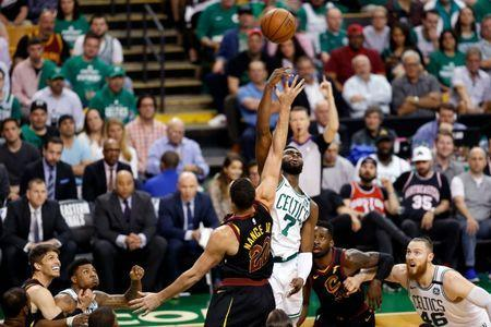 May 23, 2018; Boston, MA, USA; Cleveland Cavaliers forward Larry Nance Jr. (22) and Boston Celtics guard Jaylen Brown (7) jump for a ball during the second quarter of game five of the Eastern conference finals of the 2018 NBA Playoffs at TD Garden. Mandatory Credit: Greg M. Cooper-USA TODAY Sports