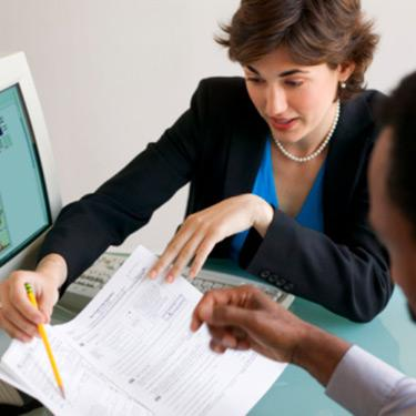 Couple-working-with-an-accountant_web