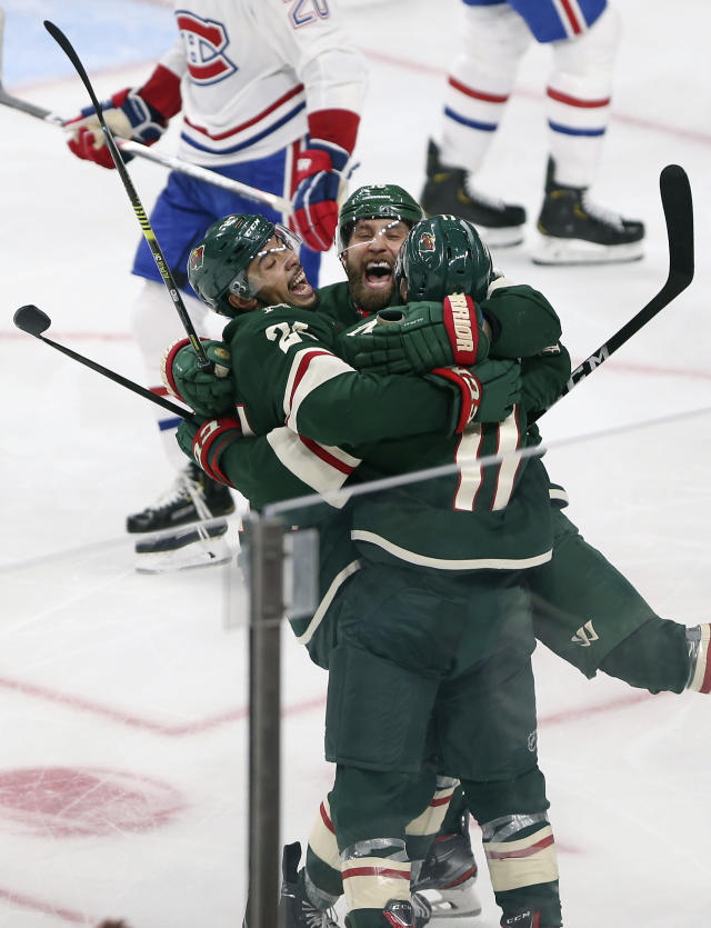 Minnesota Wild's Zach Parise, right, celebrates with teammates Jason Zucker, center, and Matt Dumba, right, after scoring a goal against the Montreal Canadiens in the third period of an NHL hockey game Sunday Oct. 20, 2019, in St. Paul, Minn. (AP Photo/Stacy Bengs)
