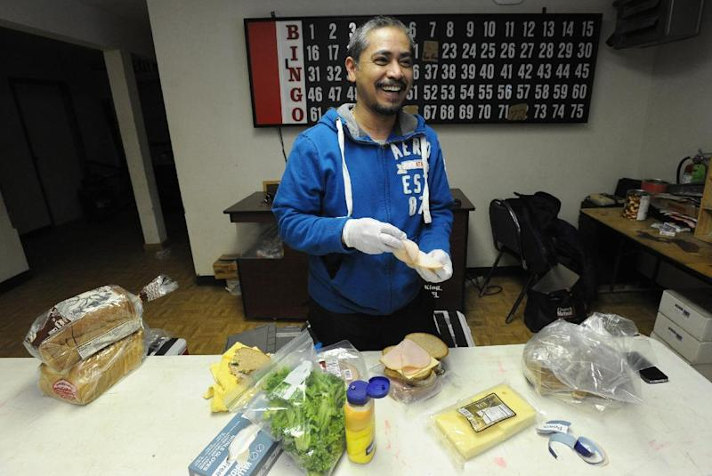 Chef Bobby Sidro of the Millennium Hotel in Anchorage makes sandwiches for folks at the Iditarod checkpoint in Anvik on Thursday, March 7, 2013.  Sidro will make a gourmet dinner for the first musher to reach the Yukon River.  (AP Photo/Anchorage Daily News, Bill Roth)