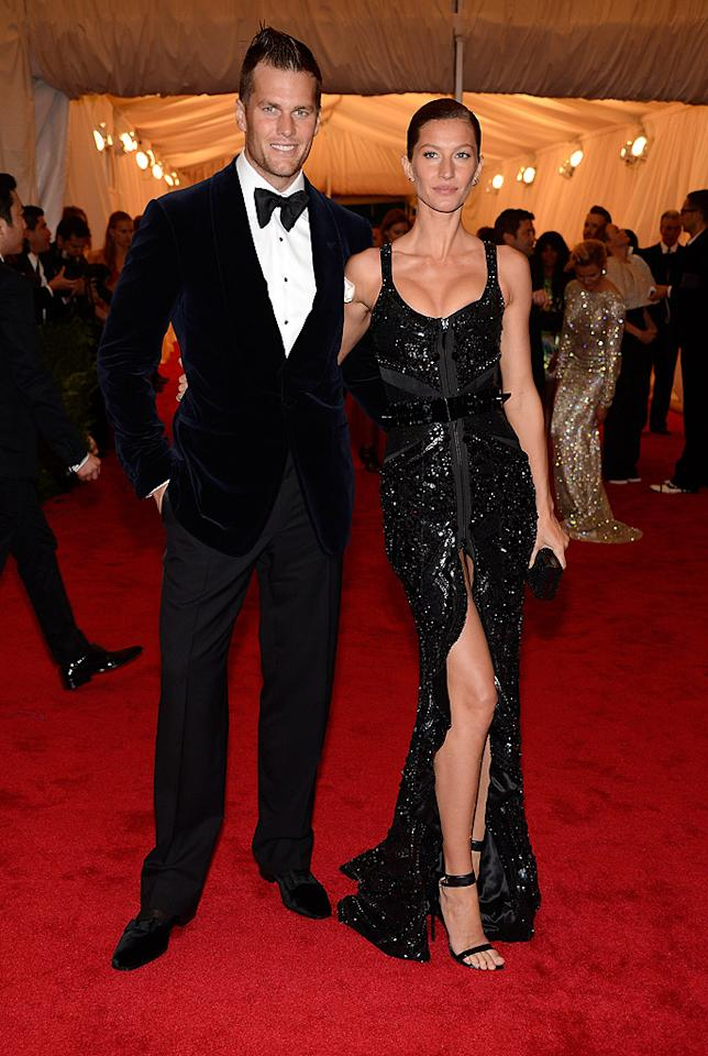 "<p class=""MsoNormal"">NFL star Tom Brady brought a hot date – his wife Gisele Bundchen. The supermodel rocked some serious cleavage in this sequined Givench<span style=""text-decoration:underline;""></span><a href=""http://www.shopstyle.com/browse/Givenchy?utm_medium=referral&utm_source=sugar-brand&utm_campaign=22997942"" target=""_blank""><span style=""color:windowtext;text-decoration:none;""></span></a>y number she paired with strappy black heels. Oh, and in case you were wondering, Tom is wearing a Tom Ford tux. </p>"