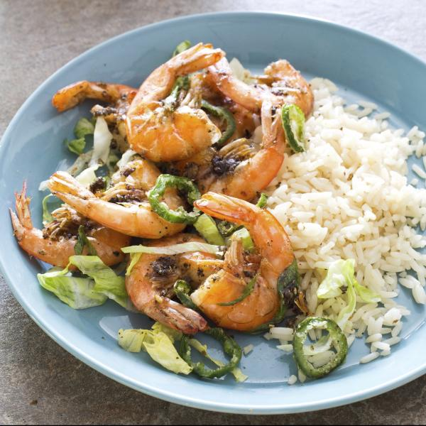 """This undated photo provided by America's Test Kitchen in May 2019 shows Crispy Salt and Pepper Shrimp in Brookline, Mass. This recipe appears in the cookbook """"Spiced."""" (Carl Tremblay/America's Test Kitchen via AP)"""