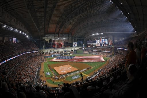 Players line up for introductions before Game 1 of the baseball World Series between the Houston Astros and the Washington Nationals Tuesday, Oct. 22, 2019, in Houston. (AP Photo/Tim Donnelly)