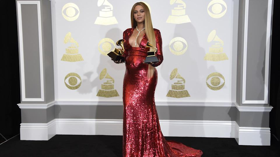 """Mandatory Credit: Photo by Invision/AP/REX/Shutterstock (9242032hb)Beyonce poses in the press room with the awards for best music video for """"Formation"""" and best urban contemporary album for """"Lemonade"""" at the 59th annual Grammy Awards at the Staples Center, in Los AngelesThe 59th Annual Grammy Awards - Press Room, Los Angeles, USA - 12 Feb 2017."""