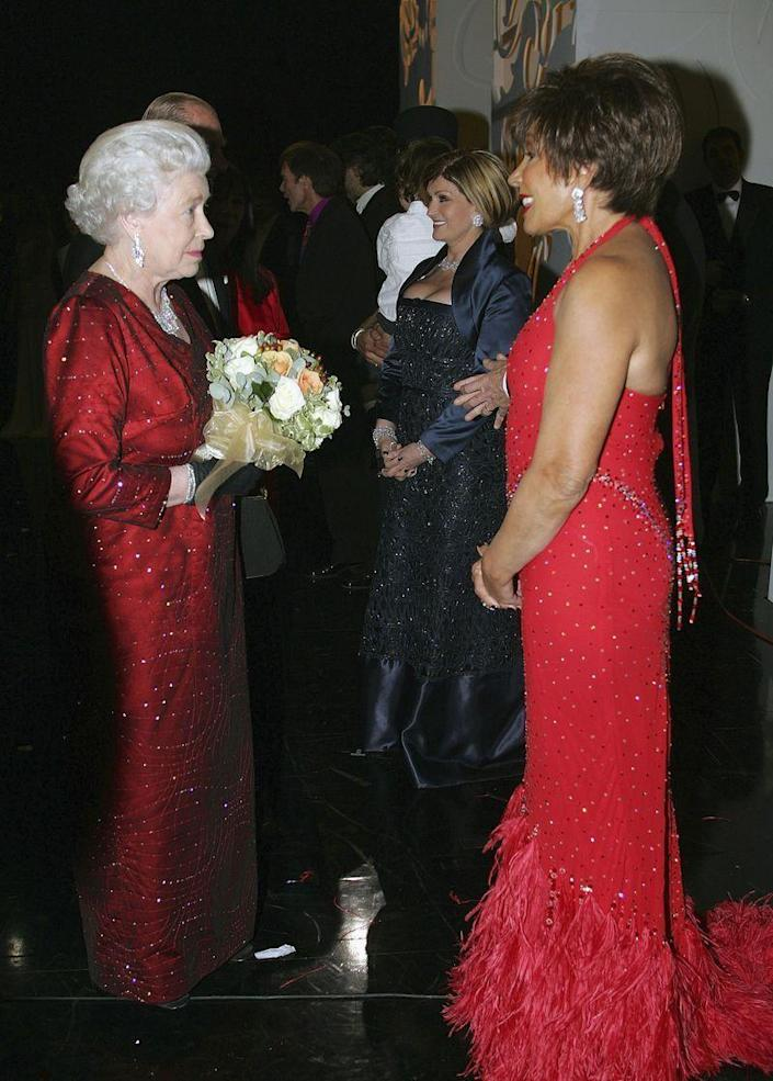 <p>Queen Elizabeth and singer Shirley Bassey had a major twinning moment while backstage at the Royal Variety Performance. Red is really both of their colors! </p>