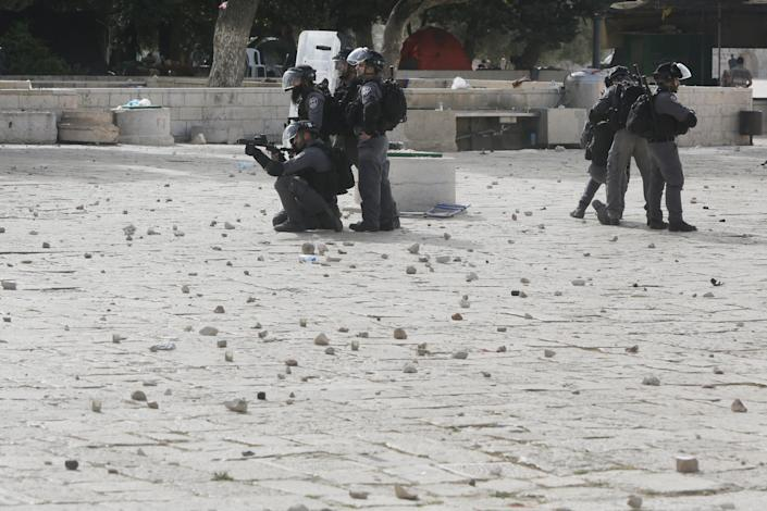 Israeli security forces take positions during clashes with Palestinians in front of the Dome of the Rock Mosque at the Al Aqsa Mosque compound in Jerusalem's Old City, Monday, May 10, 2021.