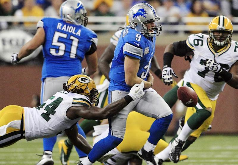 Green Bay Packers linebacker Dezman Moses, left, strips the ball away from Detroit Lions quarterback Matthew Stafford during the second quarter of an NFL football game at Ford Field in Detroit, Sunday, Nov. 18, 2012. Green Bay recovered the ball. (AP Photo/Carlos Osorio)