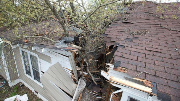 PHOTO: A tree cleaves the house on Oak Grove Avenue the day after a tornado hit, killing one person and leaving devastation throughout eastern portion of the city, April 16, 2018, in Greensboro, N.C. (Joseph Rodriguez/News & Record via AP)