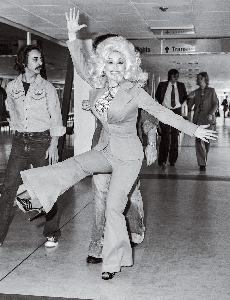 <p>Post-show high, perhaps? The singer leaving London after performing at the International Festival of Country Music at Wembley Arena.</p>