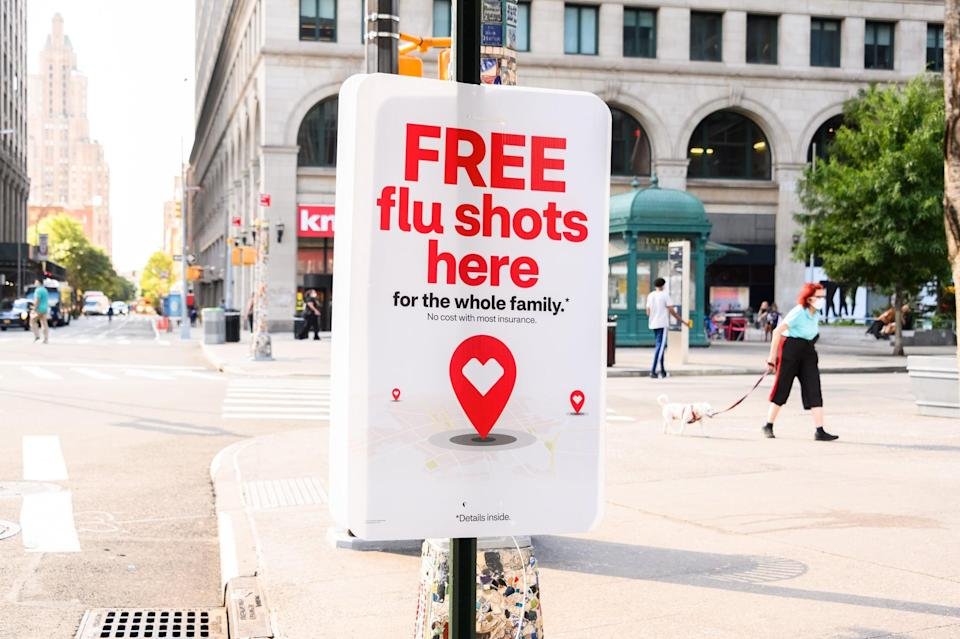 NEW YORK, NEW YORK - AUGUST 18: A sign offering free flu shots in the East Village as the city continues Phase 4 of re-opening following restrictions imposed to slow the spread of coronavirus on August 18, 2020 in New York City. The fourth phase allows outdoor arts and entertainment, sporting events without fans and media production. (Photo by Noam Galai/Getty Images)