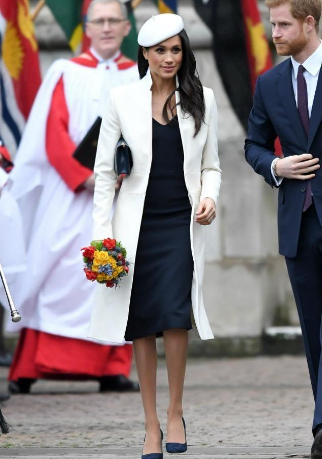 Meghan Markle looked very regal for her first public appearance with the Queen at the annual Commonwealth Service. Source: Getty