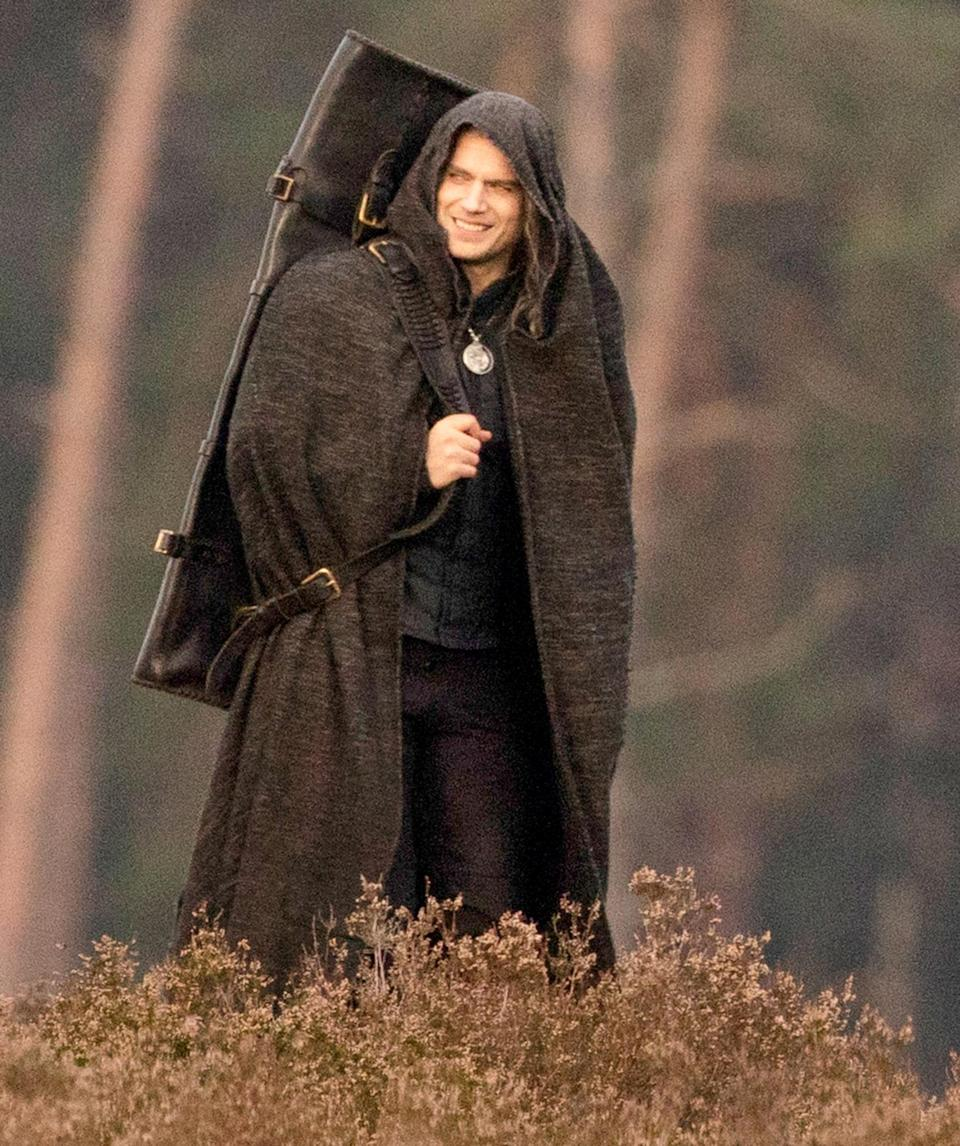 <p>Henry Cavill is seen in costume while filming the second season of <i>The Witcher</i> on Monday in Surrey, England. </p>
