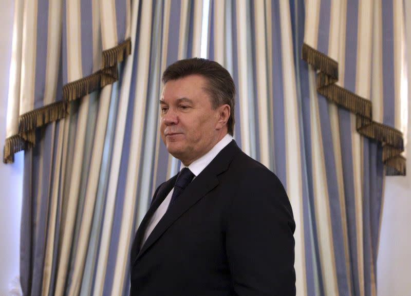 File photo of then Ukrainian President Yanukovich arriving to sign an EU-mediated peace deal with opposition leaders in Kiev