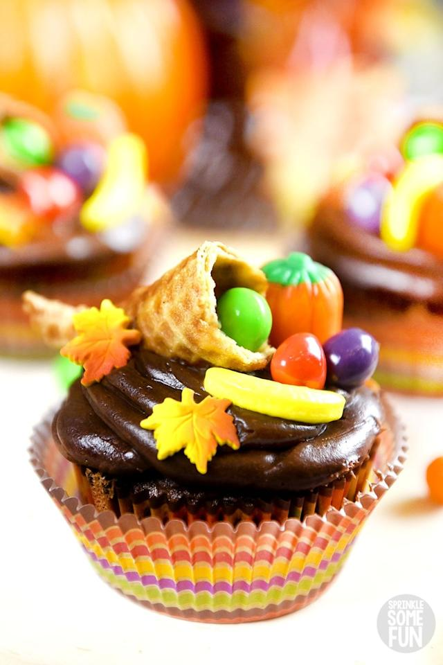 """<p>Show off your artistic abilities and craft these creative cupcakes. They're so impressive, they could double as a <a href=""""https://www.countryliving.com/entertaining/g2130/thanksgiving-centerpieces/"""">Thanksgiving centerpiece</a>.</p><p><strong>Get the recipe at <a href=""""https://sprinklesomefun.com/thanksgiving-cupcakes/"""" target=""""_blank"""">Sprinkle Some Fun</a>.</strong></p><p><strong><strong><strong><a class=""""body-btn-link"""" href=""""https://www.amazon.com/AmazonBasics-Nonstick-Carbon-Steel-Muffin/dp/B073P4RPFP?tag=syn-yahoo-20&ascsubtag=%5Bartid%7C10050.g.4709%5Bsrc%7Cyahoo-us"""" target=""""_blank"""">SHOP MUFFIN PANS</a></strong></strong><br></strong></p>"""
