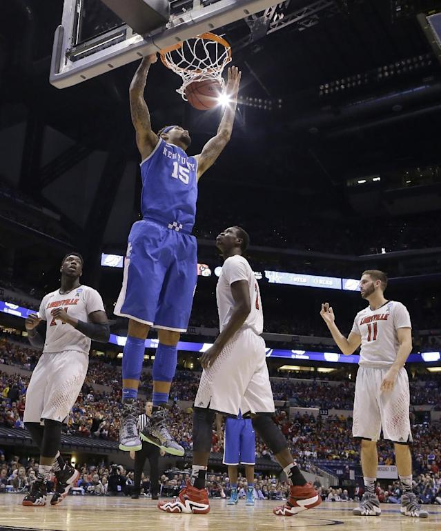 Kentucky's Willie Cauley-Stein dunks during the first half of an NCAA Midwest Regional semifinal college basketball tournament game against the Louisville Friday, March 28, 2014, in Indianapolis. (AP Photo/Michael Conroy)