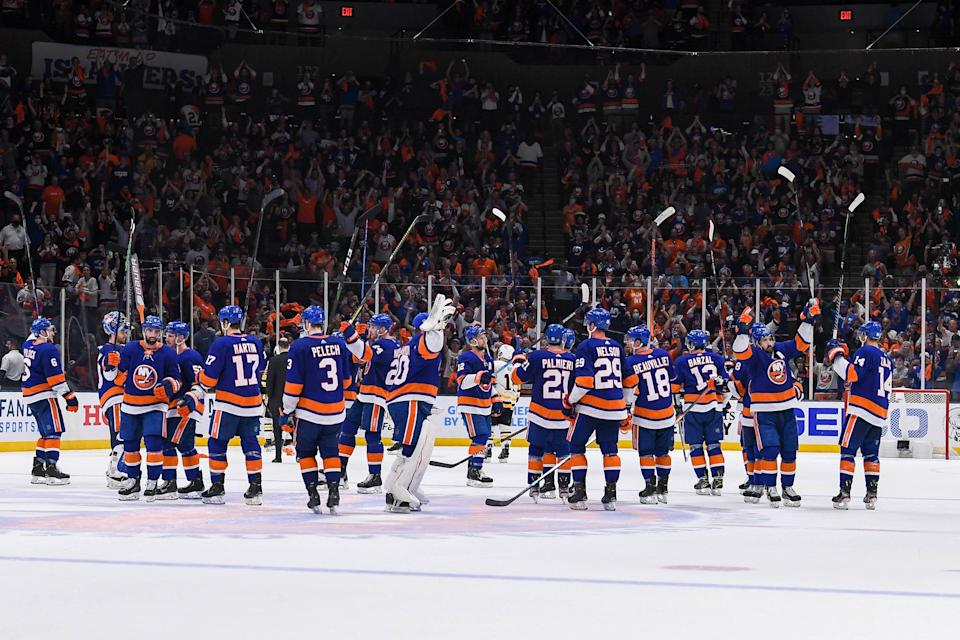 The New York Islanders salute the crowd after defeating the Pittsburgh Penguins in the first round of the 2021 Stanley Cup Playoffs.