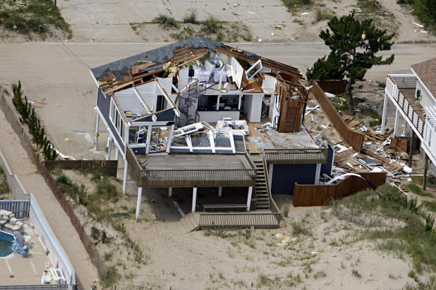 This aerial photo taken Sunday, Aug. 28, 2011 shows damage to a home in Virginia Beach, Va., after a reported tornado, spurned by Hurricane Irene, ripped through the area Saturday. (AP Photo/The Virginian-Pilot, Amanda Lucier)