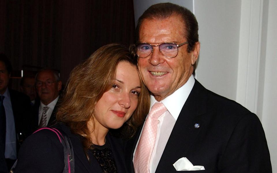 Barbara Broccoli with Sir Roger Moore, in 2003 - Getty