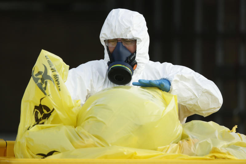 Clinical waste removal personnel are seen at St Basilâs Homes for the Aged in Fawkner, Melbourne, Friday, July 31, 2020.