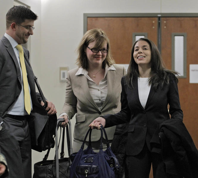 FILE- In this April 10, 2013 file photo, Fox television reporter Jana Winter, right, and her attorneys arrive at district court for a hearing for Aurora theater shooting suspect James Holmes in Centennial, Colo. Winter's lawyers want a New York appeals court to quash a subpoena that requires her to appear at a hearing in Colorado to name her sources cited in a 2012 article. She reported that Colorado shooting suspect James Holmes sent violent drawings to a psychiatrist before he opened fire on a packed movie theater in July of 2102, killing 12 people. (AP Photo/Ed Andrieski, File)