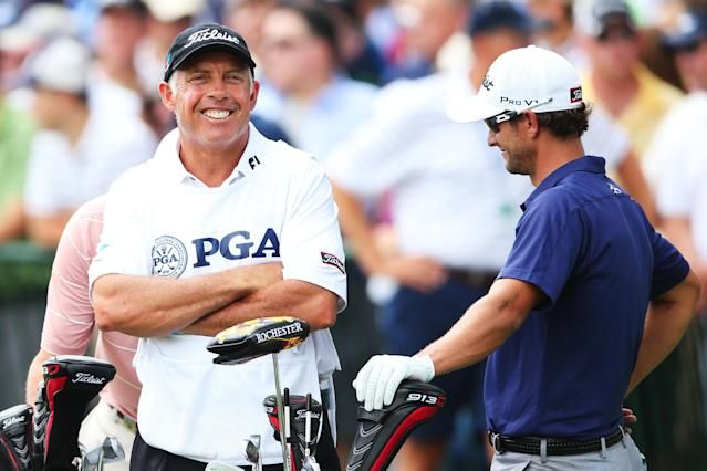 ROCHESTER, NY - AUGUST 11: Caddie Steve Williams waits with Adam Scott of Australia on the first tee during the final round of the 95th PGA Championship on August 11, 2013 in Rochester, New York. (Photo by Andrew Redington/Getty Images)