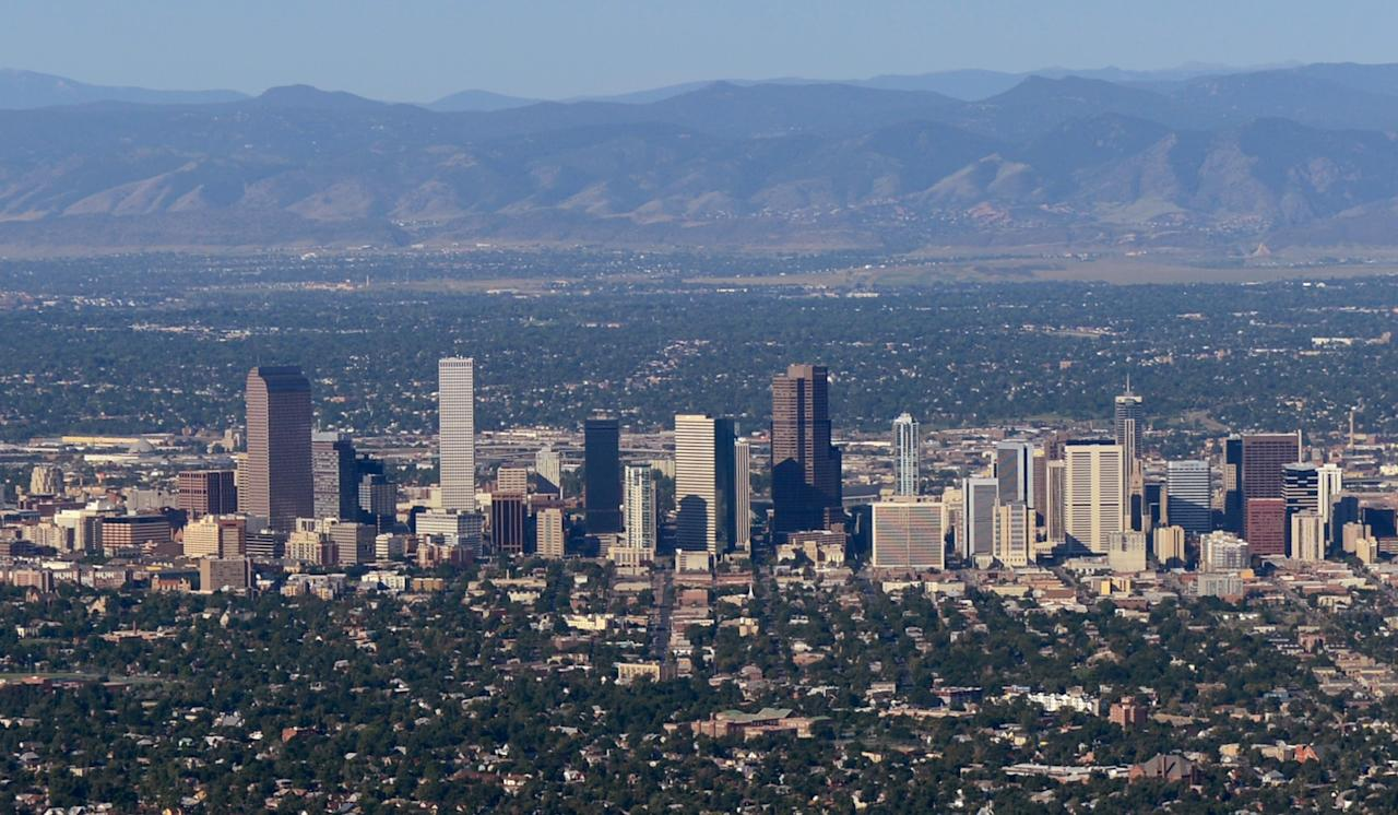 AURORA, CO - JULY 21:  The downtown Denver skyline is seen from the air a day after a gunman went on a shooting rampage at the Century 16 movie theatre during an early morning screening of the new Batman movie, 'The Dark Knight Rises,' on July 21, 2012 in Aurora, Colorado. According to reports, 12 people have been killed and over 59 injured including 9 in critical condition . Police have the suspect, twenty-four year old James Holmes of North Aurora, in custody.  (Photo by Kevork Djansezian/Getty Images)