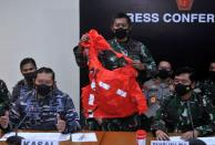 A military personnel holds an escape suit believed to be from the sunken Indonesian Navy KRI Nanggala-402 submarine during a media conference at I Gusti Ngurah Rai Airport