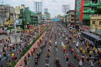 Catholic devotees attend mass on a road near Quiapo Church in Manila