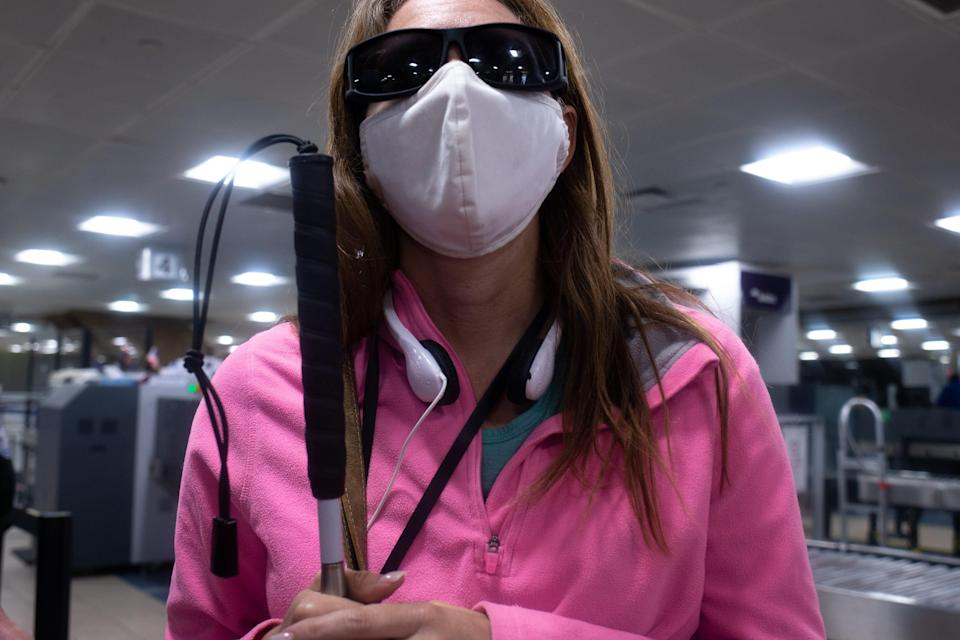 Kelly Campbell of Foundation for Blind Children takes a TSA Cares tour on Sept. 14, 2021, in Terminal 4 at Phoenix Sky Harbor International Airport.