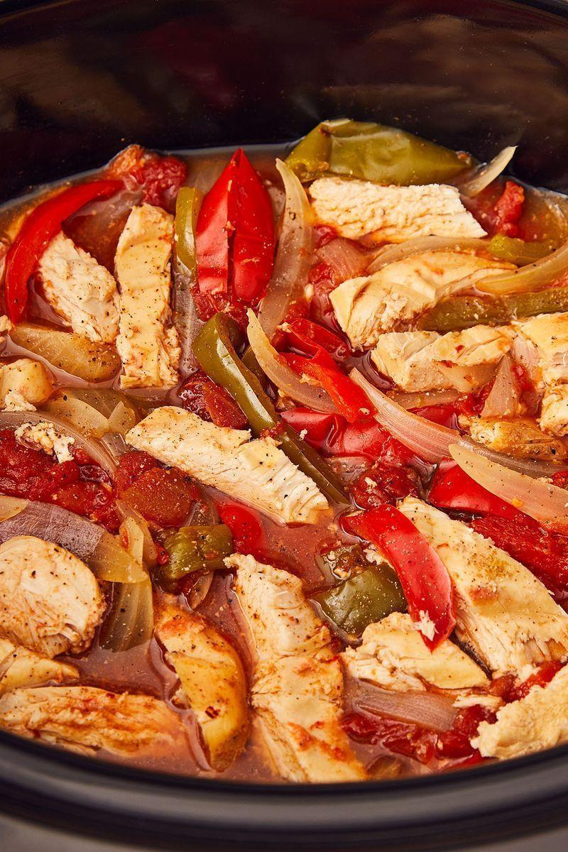 """<p><a href=""""https://www.delish.com/uk/cooking/recipes/g30220431/slow-cooker-recipes/"""" rel=""""nofollow noopener"""" target=""""_blank"""" data-ylk=""""slk:Slow cookers"""" class=""""link rapid-noclick-resp"""">Slow cookers</a> make our lives easier and these fajitas come out juicy and full of flavour!</p><p>Get the <a href=""""https://www.delish.com/uk/cooking/recipes/a30465444/crockpot-chicken-fajitas-recipe/"""" rel=""""nofollow noopener"""" target=""""_blank"""" data-ylk=""""slk:Slow Cooker Chicken Fajitas"""" class=""""link rapid-noclick-resp"""">Slow Cooker Chicken Fajitas</a> recipe.</p>"""